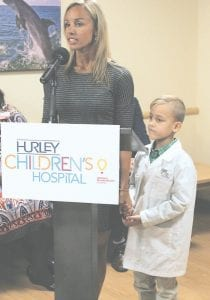 Lindsay Clark testifies to what she believes is the power of healing found in private patient rooms during a recent ribbon cutting of the private pediatric wing at Hurley Medical Center.