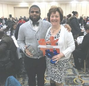 CAHS senior Cameron Reaves is the 2018 winner of the Priorities Children Youth Award, presented recently at the 23rd annual Children's Champion Breakfast. He is shown here with Principal Debbie Davis.