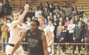 Carman-Ainsworth O'Mari Duncan drives to the hole past two Davison defenders on Feb. 16.