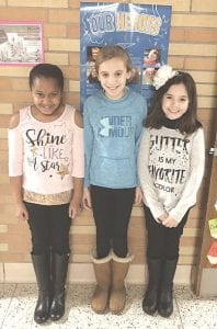 Carolyn Wistuba, right, and classmates Layla Hartington and Reese Redlich produced the video that led to the grant.