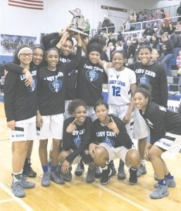 The Carman-Ainsworth girls show off their district trophy following their 63-45 win over Flushing on Friday.