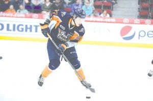 Flint's Riley McCourt lugs the puck into the offensive zone.
