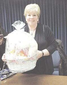 Township Trustee Carol Pfaff-Dahl showed fellow township board members one of many Easter baskets donated for an Easter Egg Hunt on Saturday morning.