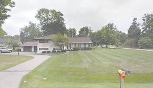 The unpublicized sale of this tax-reverted house in Western Hills caused disagreement among township board members.