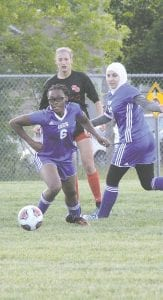 Destinee Lester (6) takes control of the ball during last season's district game against Swartz Creek. Lester had Carman-Ainsworth's lone goal of their season opener on Monday.