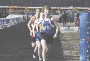 Jake Carter leads the pack for Carman-Ainsworth during the 3,200 relay at Kearsley last Wednesday.