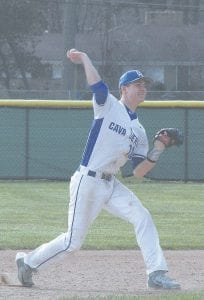 Carman-Ainsworth's Sean Jerome throws to first base after fielding a groundball against Saginaw Heritage on Monday.