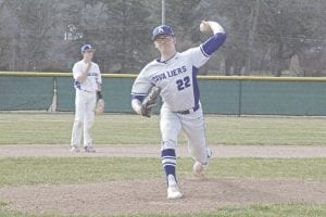 Carman-Ainsworth's Chase Matusik throws from the mound against Saginaw Heritage on April 23.
