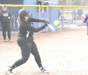 Carman-Ainsworth's Rayanne Leach swings and connects with the pitch.