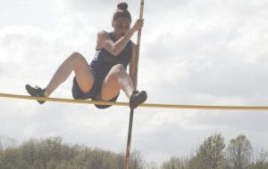 Carman-Ainsworth's Grace Pangerl clears the bar on the pole vault at Davison on Monday.