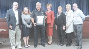 Chief Sippert (holding a proclamation) and the Flint Township Board