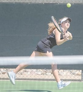 Carman-Ainsworth's Katie Speaks run through as she swats a backhand return at No. 1 Singles at the Div. 1 regional at Midland Tennis Center Thursday.