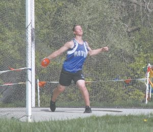 A Carman-Ainsworth athlete throws the discus at Davison on May 14.