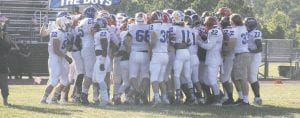 Players gather during the pregame to pump each other up prior to last year's game at Davison.