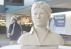 A fund drive is underway to add a bronze statue of Rosie the Riveter to heritage statues displayed in the Bishop Airport baggage claim area.