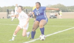 Carman-Ainsworth's Karla Bell fights for the ball against Lapeer on May 14.