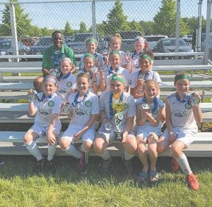 Front, left to right: Anna Weston, Addyson West, Paige Chisholm, Madalynn Hawks, Daniel Bobowski. Middle: Kendall Smith, Ella Brock, Malaya Ashley, Nia Smith. Back: Coach Kenny Uzoigwe, Sadie Kondel, Avery Dean, Hailey Wilson.