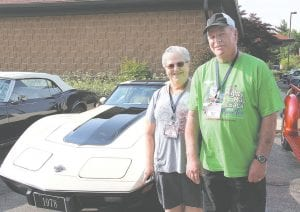 """Bob and Sue Gerds, of Millington, posed for a photo in front of their 1978 Corvette before heading out on the """"Mighty Mac and Back"""" Promo Tour, which will wind through the lower peninsula up to St. Ignace."""