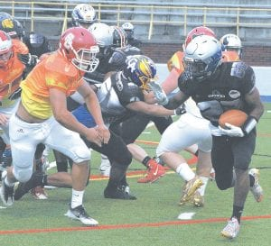 Carman-Ainsworth's Jalen Smith takes the carry during Saturday's All-Star Game at Atwood Stadium.