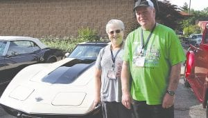 """Above: Bob and Sue Gerds, of Millington, posed for a photo in front of their 1978 Corvette before heading out on the """"Mighty Mac and Back"""" Promo Tour, which will wind through the lower peninsula up to St. Ignace."""