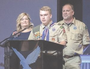 Joshua Orrison is flanked by his parents during his Eagle Scout Court of Honor ceremony. Provided photos