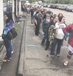 People lined up to receive tattoos, the $25 per person going toward Big Brother Big Sisters. Photo provided