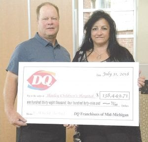 The owners of the Clio and Birch Run Dairy Queen, who are huge Children's Miracle Network supporters, recently gave a check for a significant amount to Hurley Children's Hospital. Photo by Tanya Terry