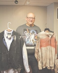 Mike Millinkov shows off some of the costumes used in the production of The Blood Crystal. Photo by Gary Gould