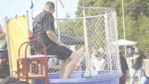 Several Flint Twp. officers took turns in the dunk tank