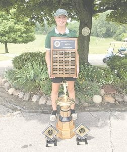 Morgan Swett of Goodrich poses with her trophies Wednesday after being named the 2018 FJGA champion.