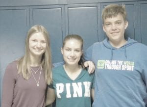 There are three German foreign exchange students at Kearsley High School experiencing life in the United States: Emelie Schuessler, Valerie Entenmann and Til Ruedel (left to right). Photo by Tanya Terry.
