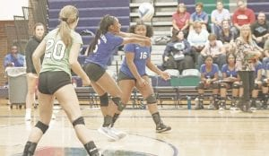 Carman-Ainsworth's Diamond Lester keeps the point alive against Lapeer on Sept. 11. Photo by Kylee Richardson