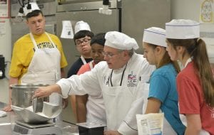 MCC Chef David Miller shows CGI students how to make bread dough from scratch. Photo provided