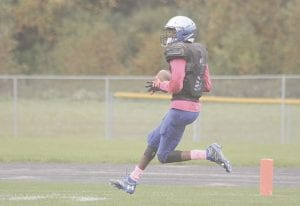 Trent Barron of Carman-Ainsworth strides into the end zone during Saturday's loss to Lapeer. Photo by Joe Oster