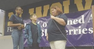Jazmin Ross of Springview Elementary School in the Flushing Community Schools district and Kaleb Thompson of Armstrong Middle School in the Kearsley Community Schools district were asked what they thought they needed to do to be a blueberry by Marjory Raymer, who emceed the Blueberry Ambassador 2018 Kickoff Party.
