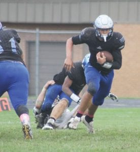 Carman-Ainsworth's Dustin Fletcher looks for an opening in the defense during the team's Week Seven loss to Lapeer on October 6. Photo by Joe Oster