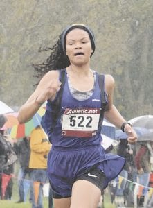 Carman-Ainsworth's Rayven Brantley approaches the finish line at the Greater Flint Championships on Oct. 6. Photo by Jolette Rossi